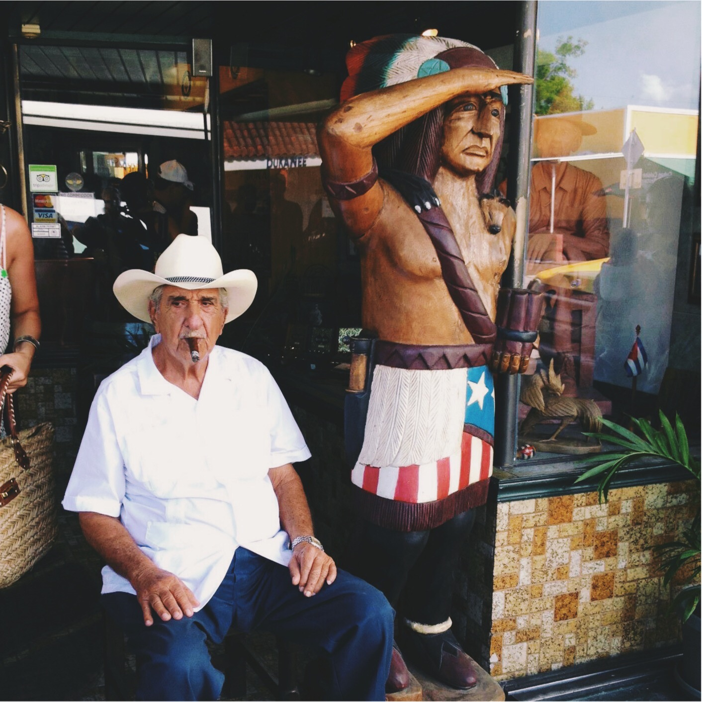 Old man smoking a cigar in Little Havana, Miami