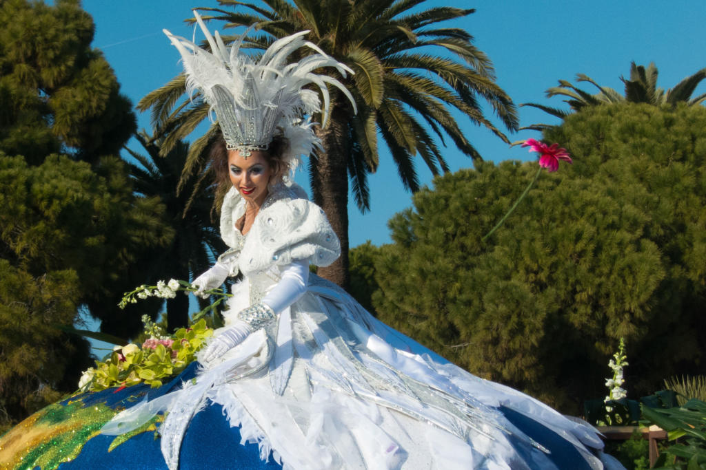"""Photos from the Battle of Flowers parade held as part of the Carnival celebration in Nice, France.  The most widely accepted etymology for the word """"Carnival"""" is """"carne levare"""" (""""away with meat""""). By the Middle Ages, the people of Nice, before fasting forty days according to the Catholic tradition of Lent, enjoyed rich, plentiful cuisine.  The better to celebrate this time of merriment, all excesses were authorized. It was also a time for mocking everything and everybody at everyone's expense, behind masks, protected by disguises until Mardi Gras.  The earliest mention of Carnival merrymaking in Nice goes back to 1294, when the Count of Provence Charles d'Anjou spent the """"the joyous days of Carnival"""" in Nice.  The tradition continues presently with a large festival held over three weeks on the streets of Nice."""