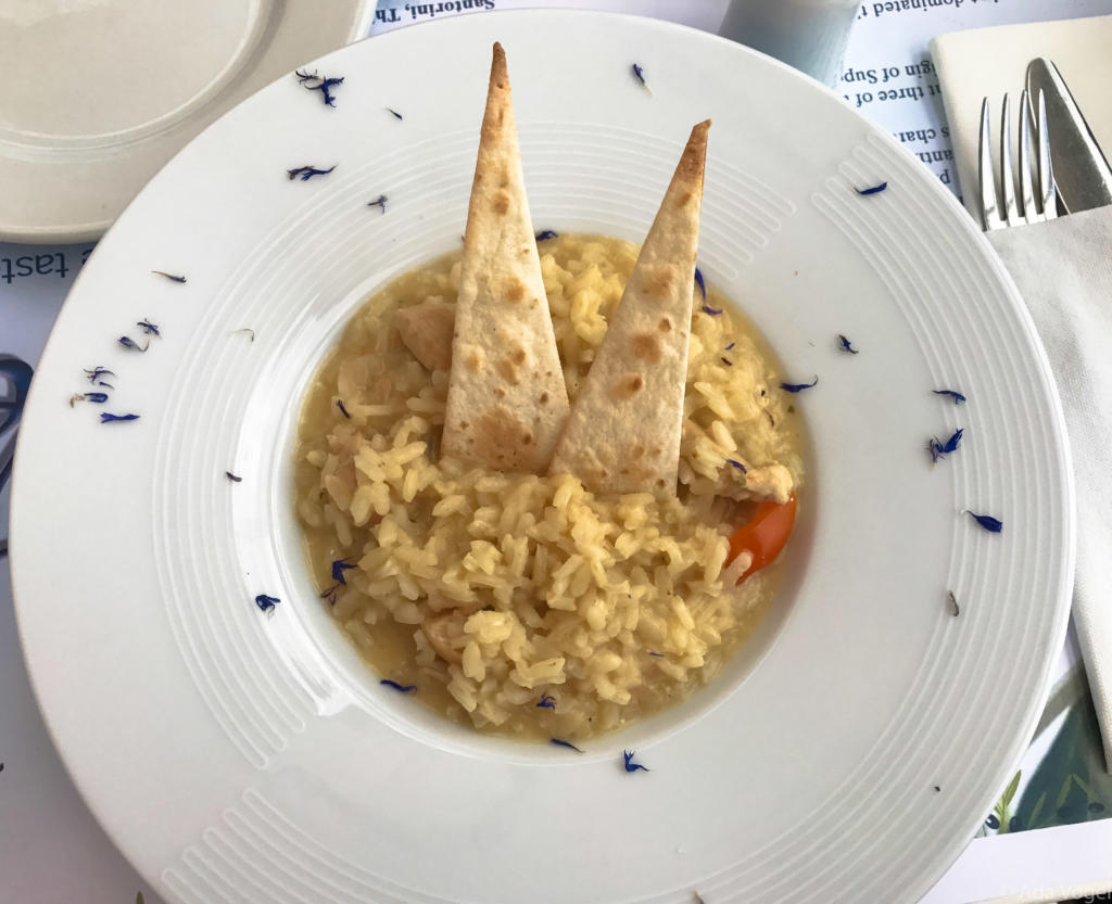 Chicken risotto served with pitta bread