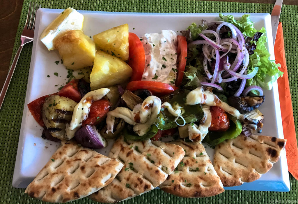 Greek pitta and vegetable salad with potatoes